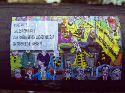 Sticker mit Cartoon zum Thema Stadionumbenennung